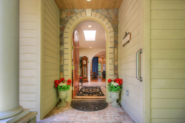 Beautiful stone arch-front door - Oregon builders