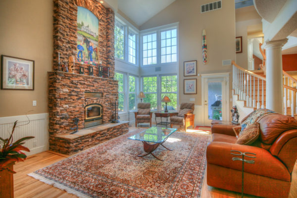 multicolored stone fireplace - custom Oregon home