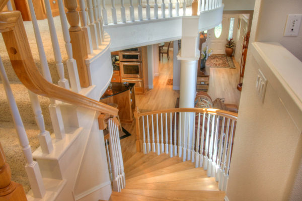 Stunning wooden stairwell - custom built Oregon homes