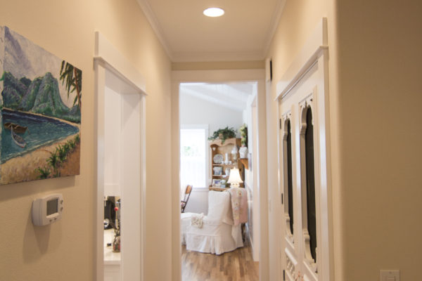 hallway featuring white cut-out designed door - Oregon