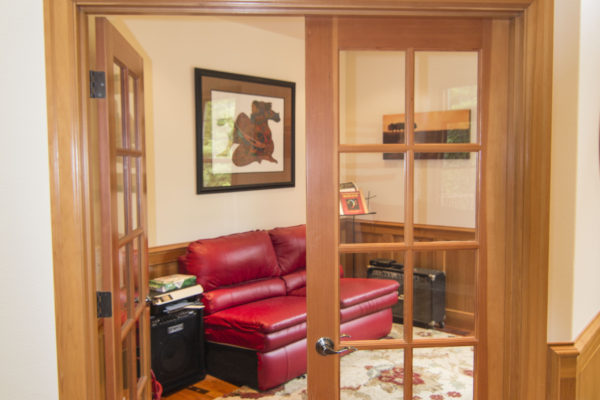 Custom wood doorframe with windowed doors - office entry