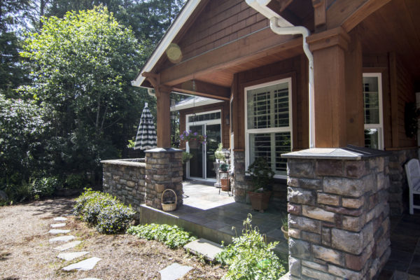 Pillared front patio - Custom built Oregon home